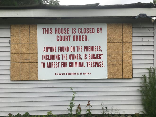 The home at 37920 Washington Ave. near Selbyville was boarded up by Delaware State Police and the Department of Justice.