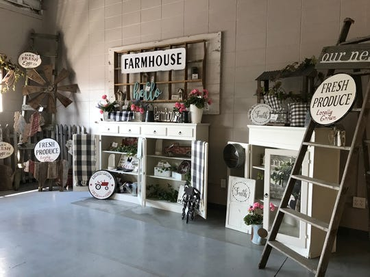 A farmhouse display set up at Milkweed Market in Wisconsin Rapids.