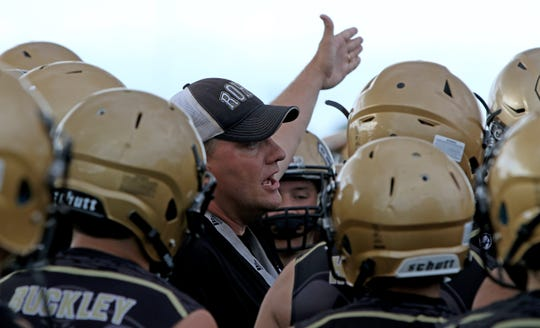 Rider head football coach Marc Bindel tells his team where to go on the first day of two-a-day practices Monday, Aug. 13, 2018, at the Rider High School football fields.