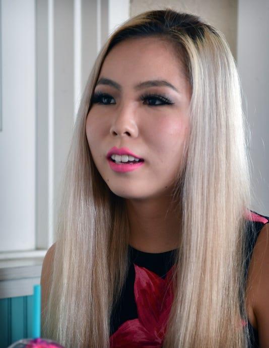 Asian Hooters girl racial slur
