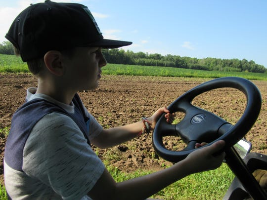 Eli driving with Grandma as co-pilot.