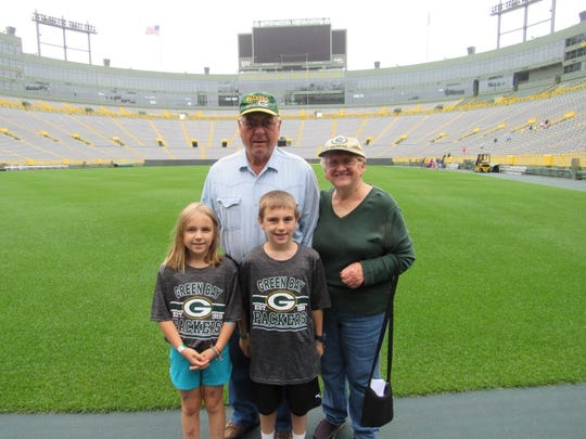 Grandpa Bob, Grandma Susan, Arianna, and Eli at Lambeau field.