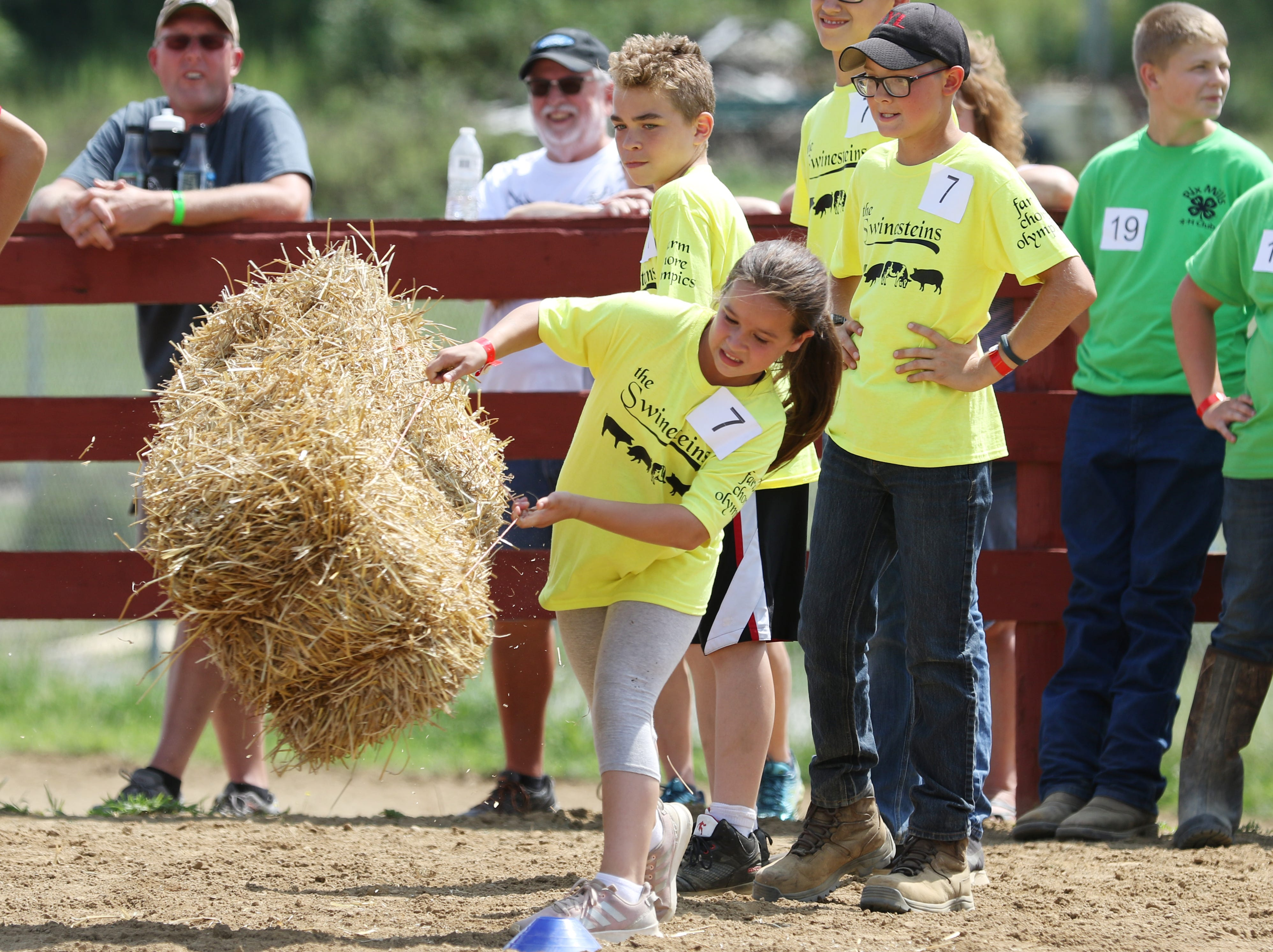 The Junior Fair presented a new event on Monday, the Farm Chore Olympics. The event started with the pooper scooper task, then a egg toss, followed by a hay bale toss, water relay, and finally a water melon seed spitting contest.