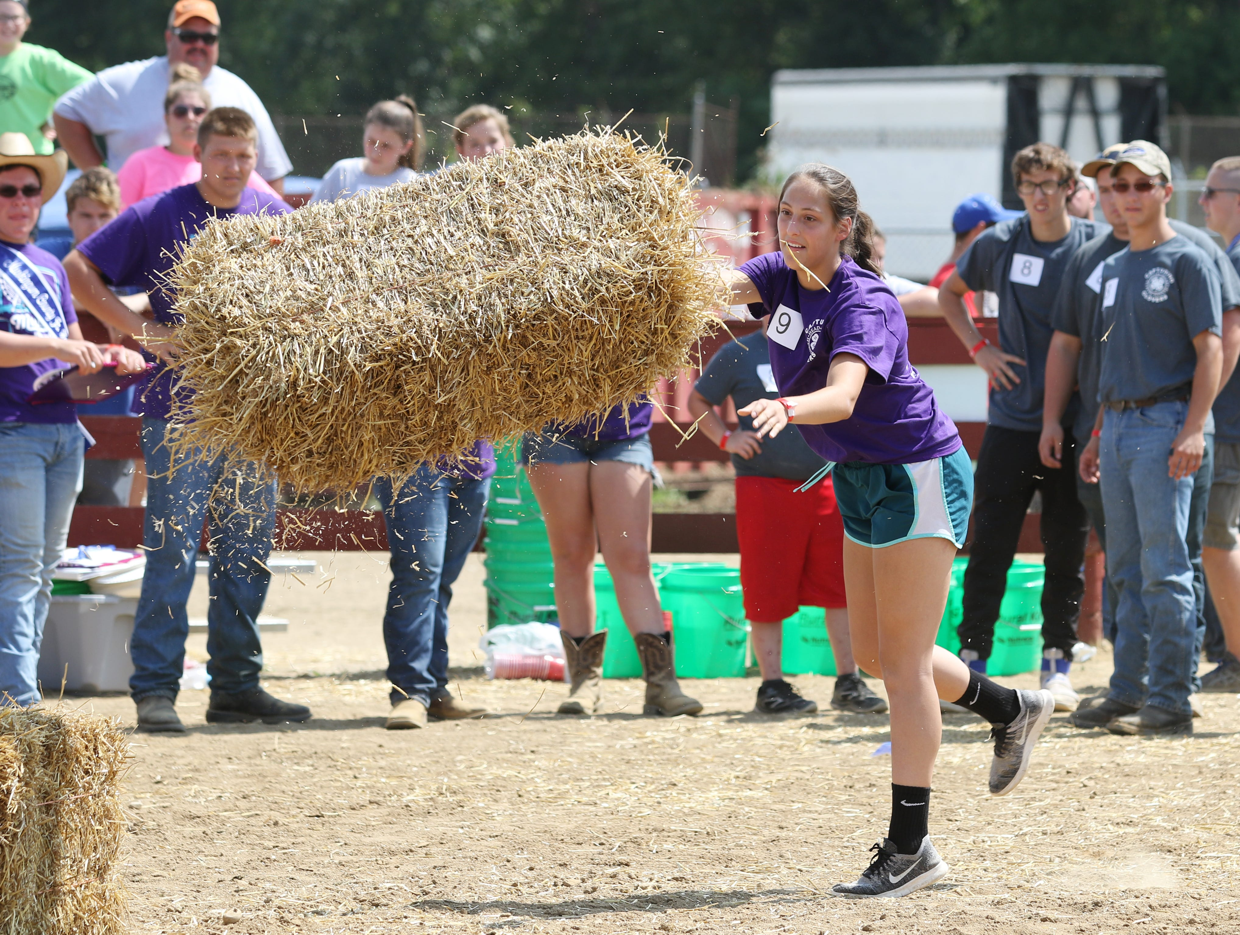The Junior Fair presented a new event on Monday, the Farm Chore Olympics. The event started with the pooper scooper task, then a hay bale toss, followed by an egg toss, water relay, and finally a water melon seed spitting contest.