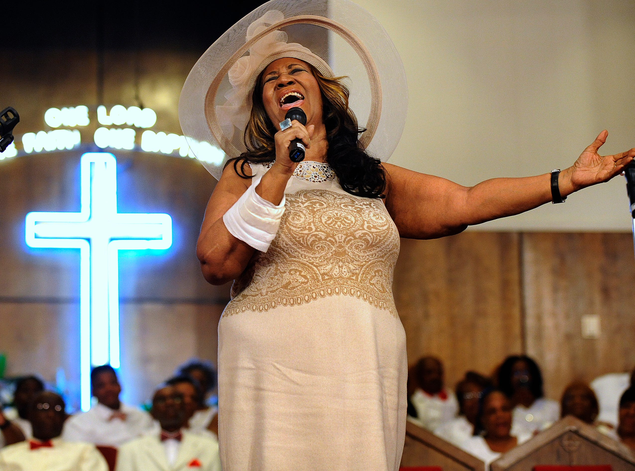 FILE - In this June 7, 2015 file photo, Aretha Franklin sings during a memorial service for her father and brother, Rev. C.L. and Rev. Cecil Franklin, at New Bethel Baptist Church where they were ministers, in Detroit, Mich. A person close to Franklin said on Monday that the 76-year-old singer is ill. Franklin canceled planned concerts earlier this year after she was ordered by her doctor to stay off the road and rest up.  (Elizabeth Conley/The Detroit News via AP, File) ORG XMIT: MIDTN901