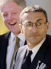 President Bill Clinton laughs as he listens to newly appointed White House Chief of Staff John Podesta on Oct. 20, 1998. Podesta previously served as deputy chief of staff and White House staff secretary.