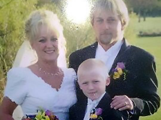 Greg Manteufel, 48, of West Bend, Wisconsin, right, with his wife, Dawn, and their son, recently lost his legs and hands to a blood infection because of a lick from a dog.