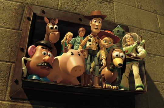 "Woody (voiced by Tom Hanks, center) and the whole gang starred in the Pixar powerhouse ""Toy Story 3."""