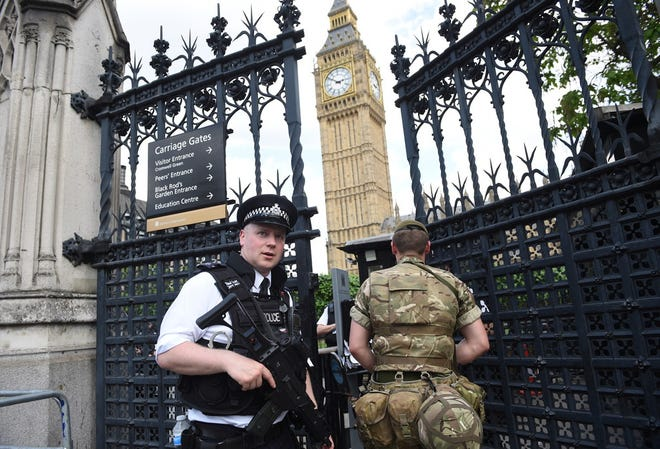 British Army soldiers and police patrol the streets near the Houses of Parliament in London, in May 2017.