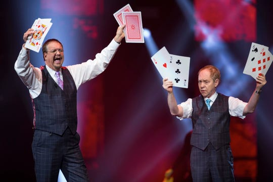 """Penn Jillette, left, and Raymond Teller perform their """"Penn & Teller"""" act in Las Vegas in Decemger 2017."""