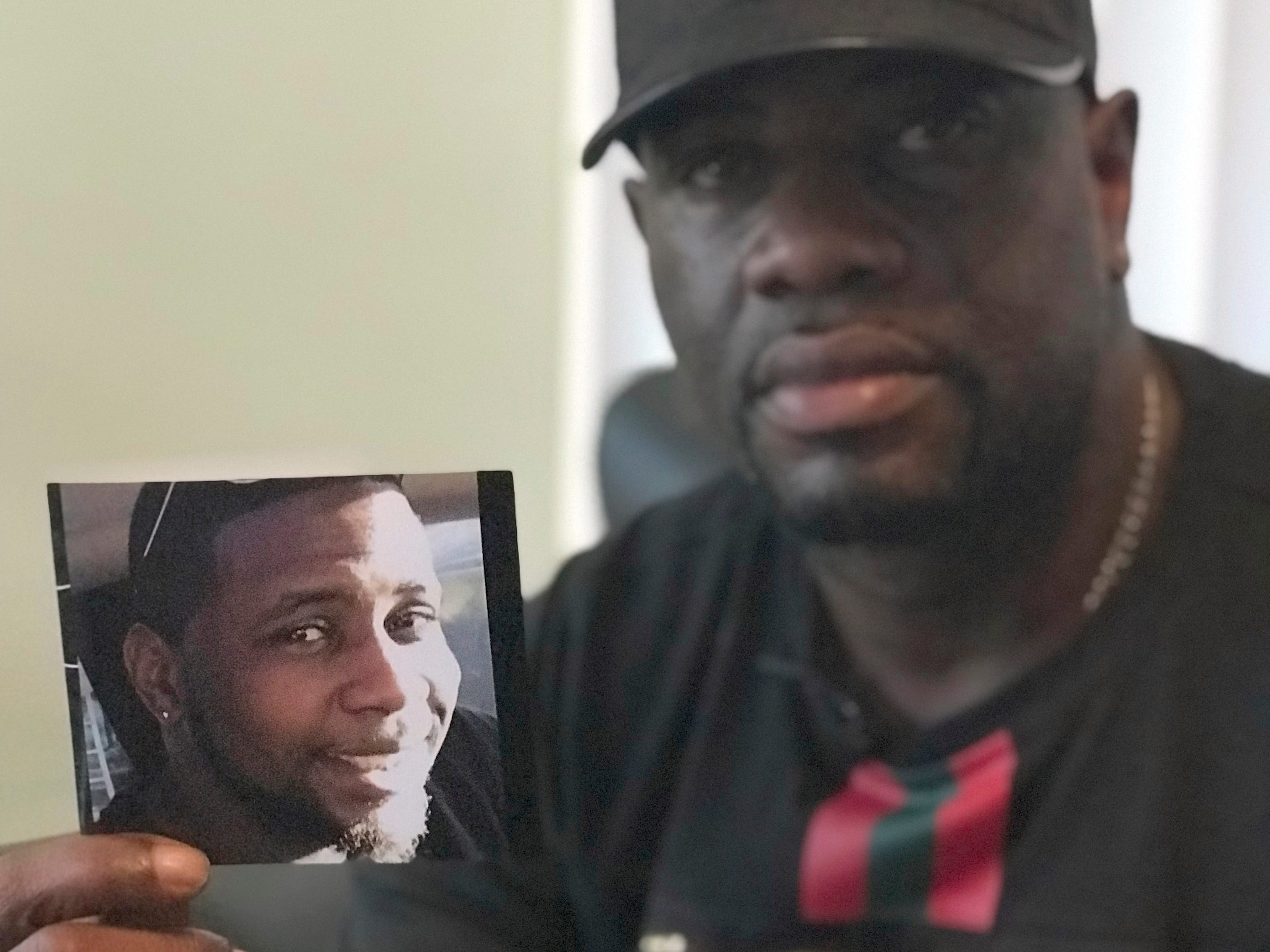 Michael McGlockton holds a photo of his son, Markeis McGlockton, who was shot and killed on July 19 in Clearwater, Florida during an argument over a parking spot.