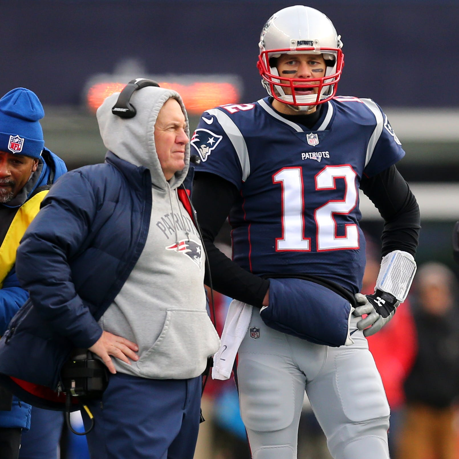Patriots coach Bill Belichick stands with quarterback Tom Brady during a 2017 game.