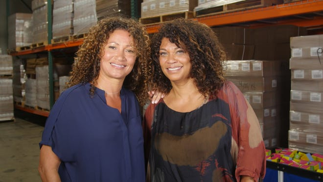 Wendi Levy Kaaya (left) and Kim Etheredge built their Mixed Chicks hair-care company by sharing the products they created for their own multi-ethnic hair.