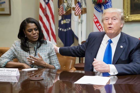 US President Donald J. Trump (R) speaks beside then Director of Communications for the Office of Public Liaison Omarosa Manigault-Newman (L) during a meeting on African American History Month in the Roosevelt Room of the White House in Washington, DC, USA, 01 February 2017.