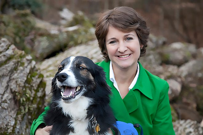 Jennifer McQuiston, with one of her dogs, is deputy director of the Division of High Consequence Pathogens and Pathology in the National Center for Emerging and Zoonotic Infectious Diseases at the federal Centers for Disease Control and Prevention in Atlanta.