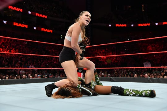 """Ronda Rousey puts her signature armbar on Alicia Fox on USA's """"Monday Night Raw."""" Rousey wrestles rival Alexa Bliss for the Raw women's championship Sunday at """"SummerSlam."""""""