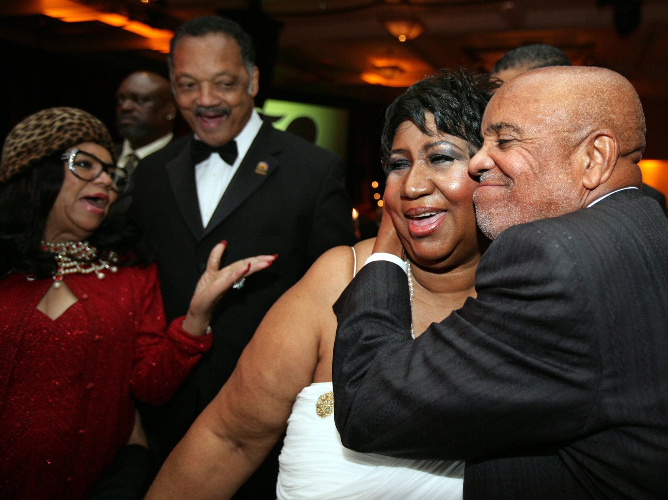 November 2009; Detroit, MI, USA; Berry Gordy hugs Aretha Franklin while Jesse Jackson and a guest looks on at the Motown 50 Golden Gala Live it Again Weekend at the Marriott in the Renaissance Center in Detroit.   Mandatory Credit: Kimberly P. Mitchell /Detroit Free Press via USA TODAY NETWORK ORIG FILE ID:  20180812_ajw_usa_058.jpg
