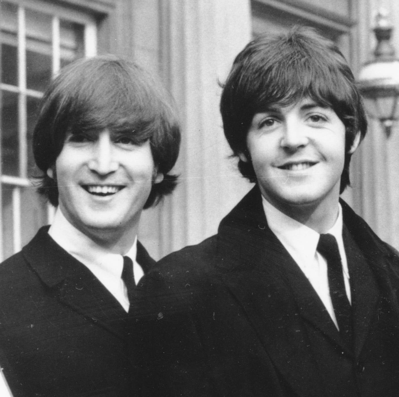 John Lennon, left, and Paul McCartney have some strong genes.