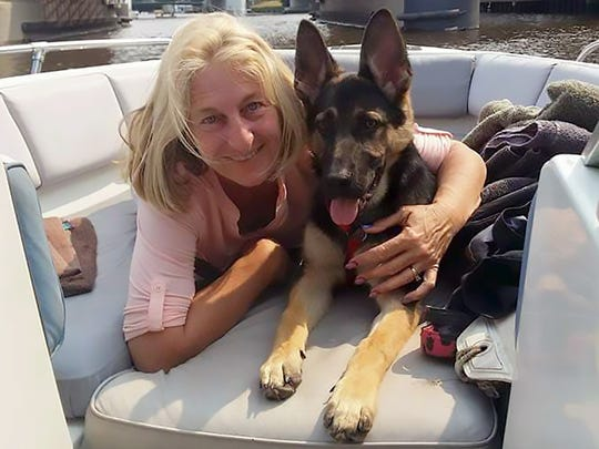 Sharon Larson, 58, of South Milwaukee with one of the family dogs. A puppy nipped her June 19, 2018, creating an infection that resulted in her death four days later.