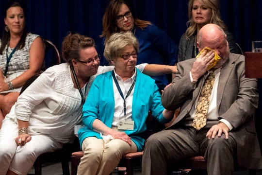 August 14, 2018; Harrisburg, PA, USA;  James Faluszczuk, right, who was abused in the Erie diocese, cries as Attorney General Josh Shapiro outlined the findings of the grand jury investigation into six catholic diocese in Pennsylvania. The grand jury's report detailed child sexual abuse and coverup by more than 300 clergy.