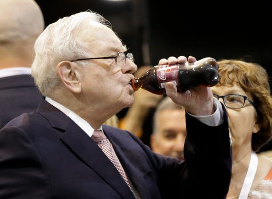 Warren Buffett, Berkshire Hathaway Chairman and CEO, drinks a Cherry Coke as he tours the exhibit floor at the CenturyLink Center in Omaha, Neb., Saturday, May 6, 2017, where company subsidiaries display their products. More than 30,000 people are expected to attend the annual Berkshire Hathaway shareholders meeting where Buffett and his Vice Chairman Charlie Munger preside over a Q&A session. (AP Photo/Nati Harnik) ORG XMIT: NENH1