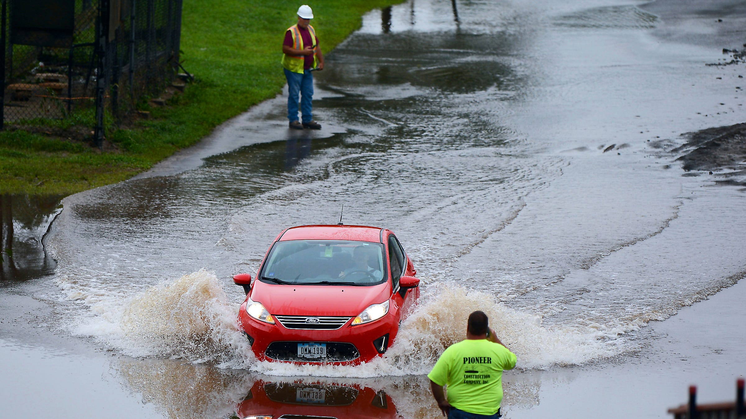 A motorist braves the flood waters on Richter Avenue in Scranton, Pa., on Tuesday, Aug. 14, 2018. Heavy rains overnight caused flooding in a wide swath of Pennsylvania on Monday, including areas soaked by a series of unusually heavy rains in recent weeks.