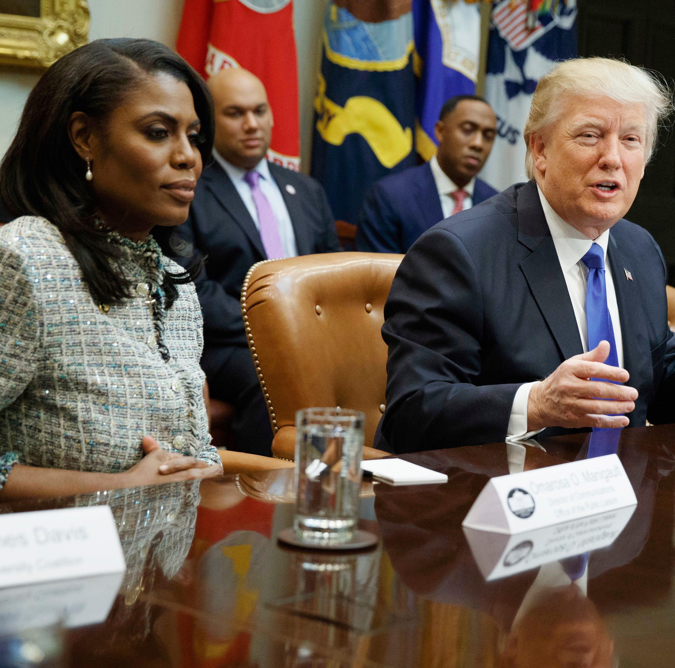 President Donald Trump and then-aide Omarosa Manigault Newman in happier times.