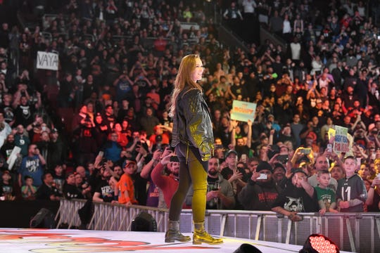 Ronda Rousey basks in the cheers of WWE fans.