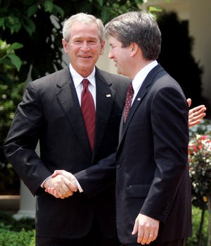 President George W. Bush  congratulates Brett Kavanaugh after he was sworn in as a federal appeals court judge at a White House ceremony on June 1, 2006. Kavanaugh previously served as White House staff secretary.