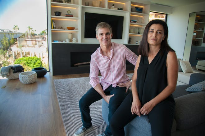 Homeowner Robert Balzebre and designer Abeer Sweis in the living room of Balzebre's home in the Hollywood Hills of Los Angeles. Balzebre, with design firm SweisKloss, built the home with highly fire-resistant materials.
