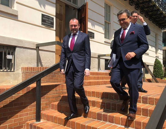 Mexican Foreign Minister Luis Videgaray, left, and Economy Minister Idelfonso Guajardo leave the Office of the United States Trade Representative Robert Lighthizer in Washington, Friday Aug.10, 2018.