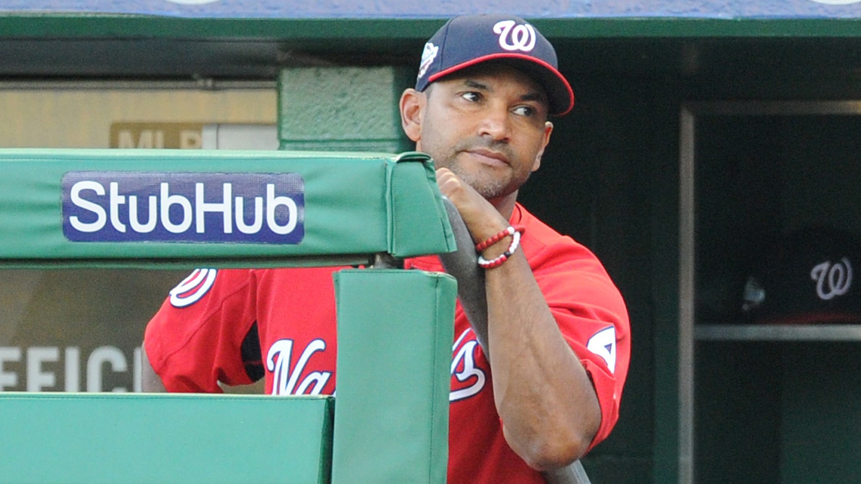 Washington Nationals manager Dave Martinez (4) looks on from the dugout in a July game.