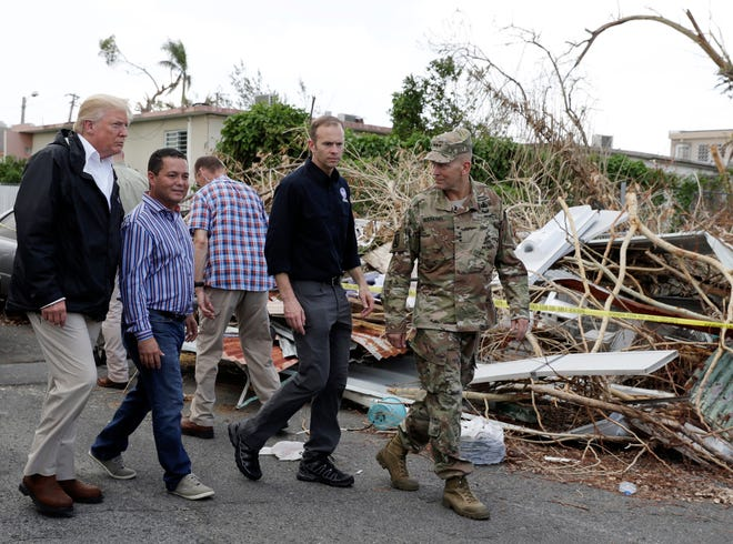 President Donald Trump and FEMA Administrator Brock Long, second from right, in Guaynabo, Puerto Rico, on Oct. 3, 2017.