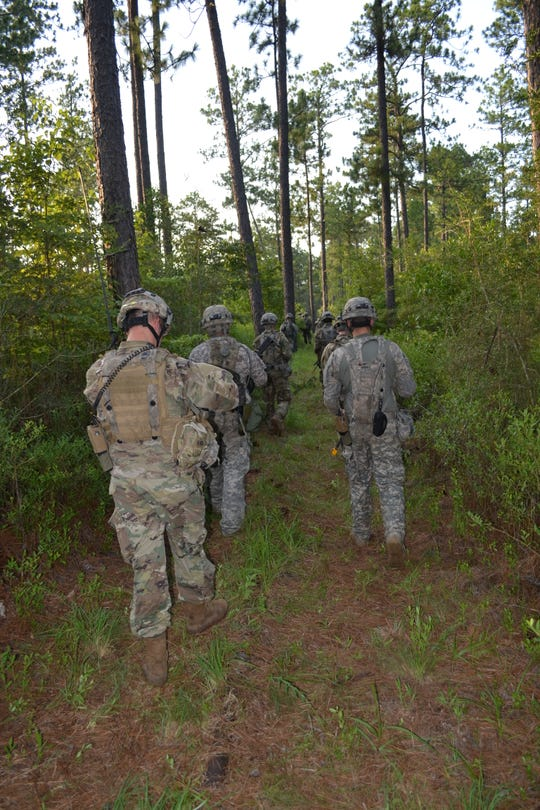 Members of the La. National Guard 3rd Battalion, Bravo Company, based at Camp Beauregard leave their campsite to run a training mission during XCTC training at Camp Shelby, Miss.