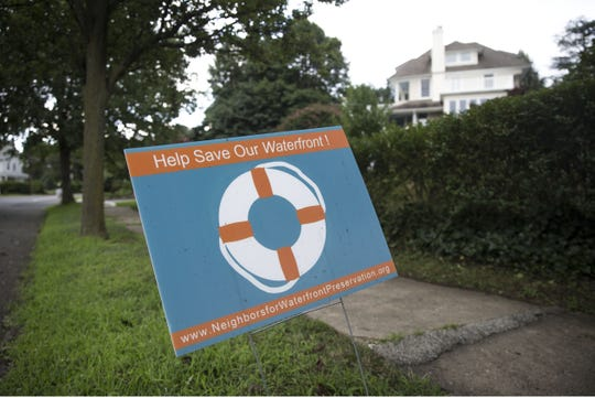 Signs like this on Ocean Blvd. appear throughout the town. Concerned residents of Atlantic Highlands are hoping to preserve a piece of waterfront land from being developed.