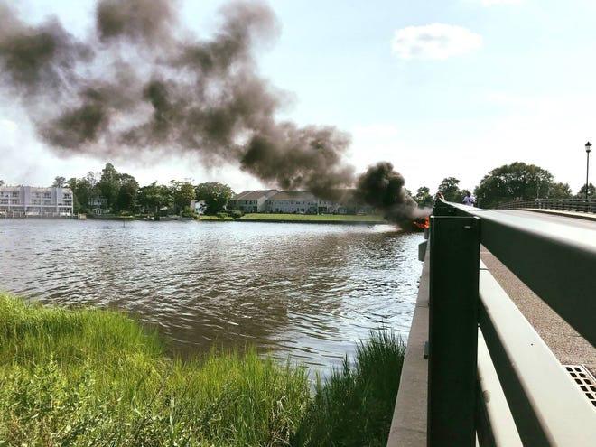 The Patten Avenue Bridge has been closed because of a boat fire.