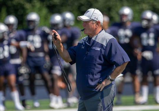 Monmouth University Head Football Coach Kevin Callahan times plays during Monmouth University football practice on August 15, 2018 in West Long Branch, NJ.