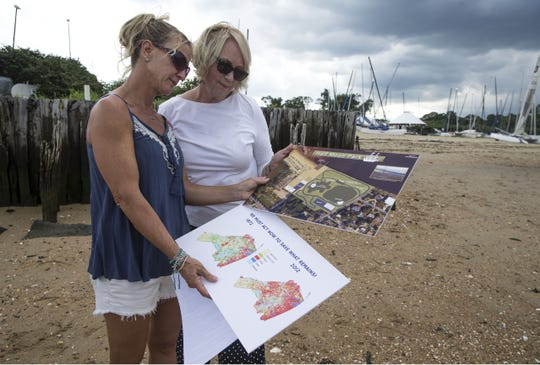 Laurie Zydel and Marilyn Scherfen, both residents of Atlantic Highlands, look over illustrations involving the land in question.