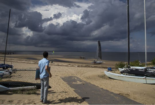 Robert O'Connor of Atlantic Highlands takes photographs of the summer sky. Concerned residents of Atlantic Highlands are hoping to preserve a piece of waterfront land from being developed.