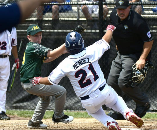 Middletown New Jersey Little League's Reid Tully (3) tags out Mid Island New York's Derek Mendez (21) at Breen Field in Bristol, Connecticut.  MIKE ORAZZI/CORRESPONDENT