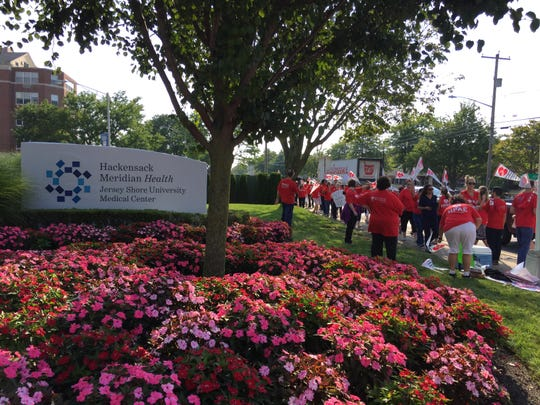 Nurses at Jersey Shore University Medical Center picket on Wednesday, calling for better staffing.