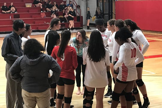 Sweetwater volleyball coach Morgan Doyle (center) talks to her team during a timeout Tuesday at the Mustang Gym. The Lady Mustangs defeated Clyde 25-23, 25-20, 25-17.