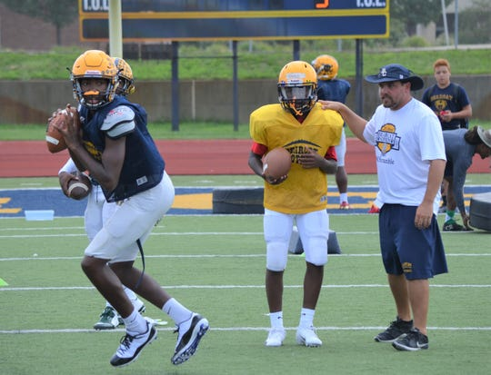 BCC assistant coach Casey Bess works with quarterbacks during a preseason practice earlier this week.