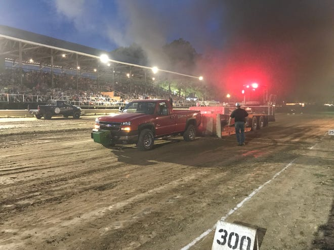 The truck owned by the late Zack Neal is  driven by his grandfather, Conrad Richards, competes in the truck pull at the Calhoun County Fairgrounds on Tuesday, August 14, 2018.