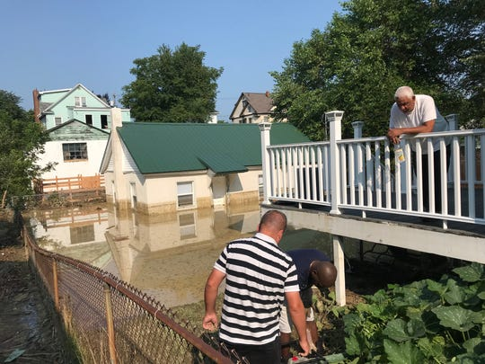A home at 19 Louisa St., in Binghamton, was among the residences impacted by flash flooding.