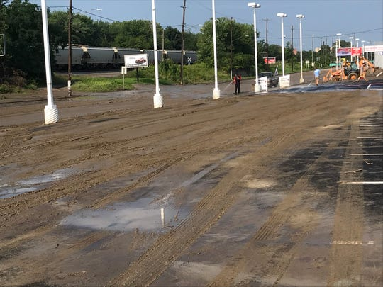Court Street in Binghamton was filled with mud and debris after Tuesday evenings heavy rains and flash flooding.