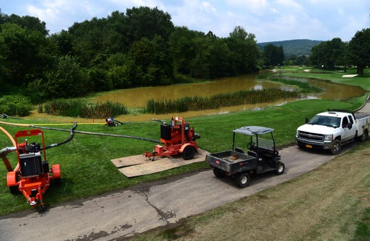 The grounds crew brought in pumps to assist in the cleanup at the 15th hole at En-Joie Golf Course in Endicott on Wednesday, Aug. 15, 2018.