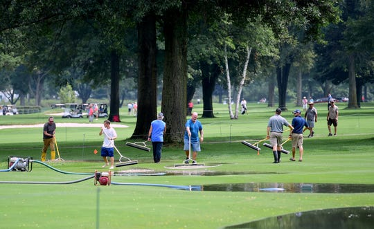 Ground crews work to clean up water on No. 5 at En-Joie Golf Course in Endicott as the Dick's Sporting Goods Open gets underway on Wednesday, August 15, 2018.