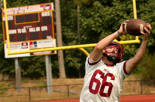 Kingston's Daniel Afton makes a catch during practice on Wednesday, the first day high school teams were allowed back on the practice field for the fall season.