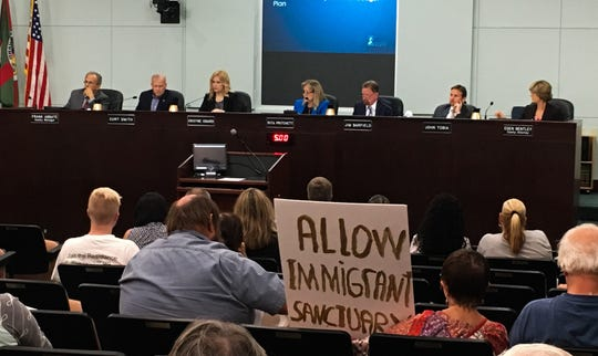 """Members of the public listen to the Brevard County Commission discuss   Commissioner John Tobia's resolution designed to guard against the county becoming a """"sanctuary""""for illegal immigration. The resolution passed, 5-0, despite 26 members of the public  speaking in opposition to it."""